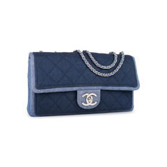 Chanel denim flap bag with chanel charm 2?1542697126