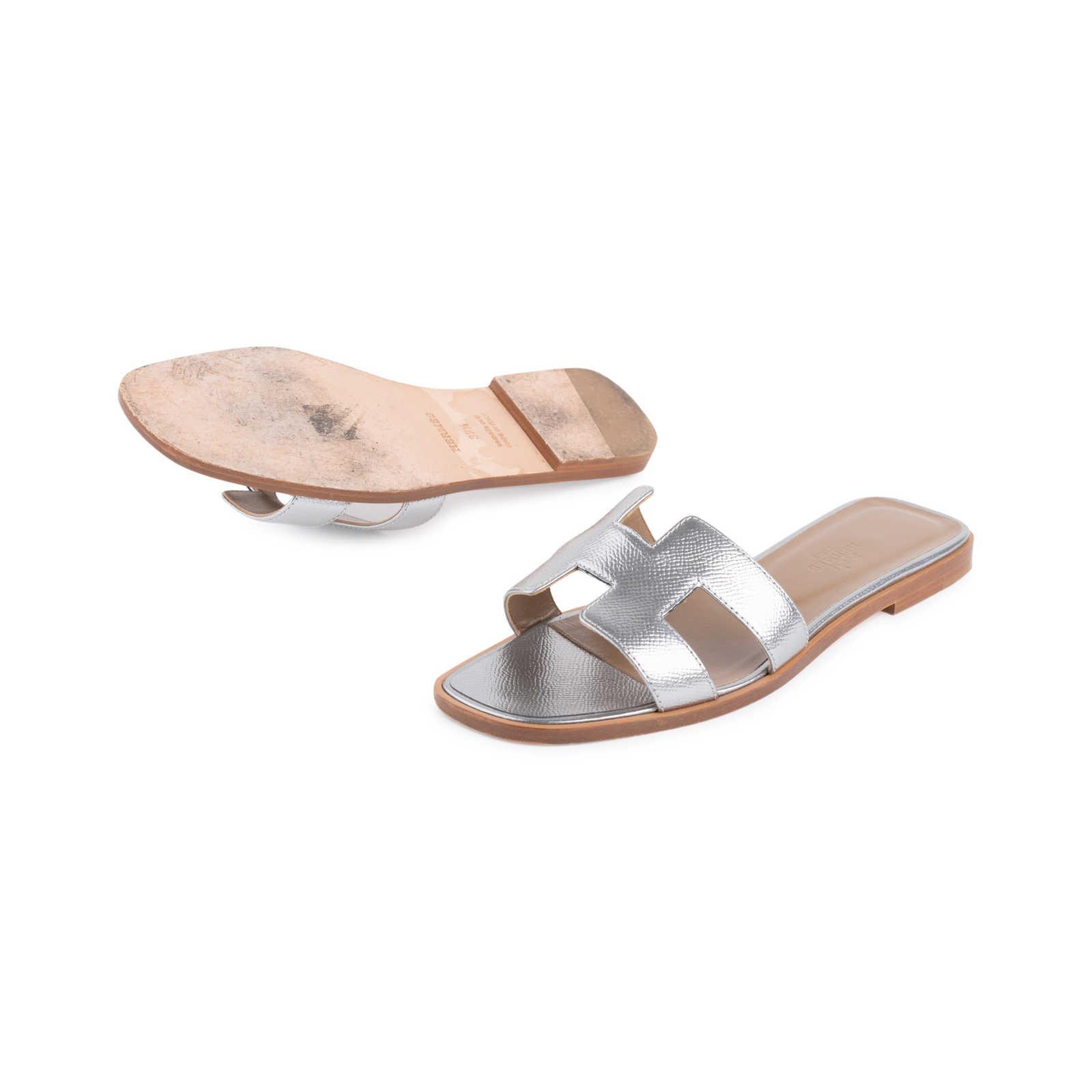 0a447b5f7585 ... Authentic Second Hand Hermès Metallic Epsom Oran Sandals  (PSS-126-00139) ...